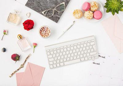 top-view-of-white-office-female-workspace-with-pc-PCJVTC5.jpg